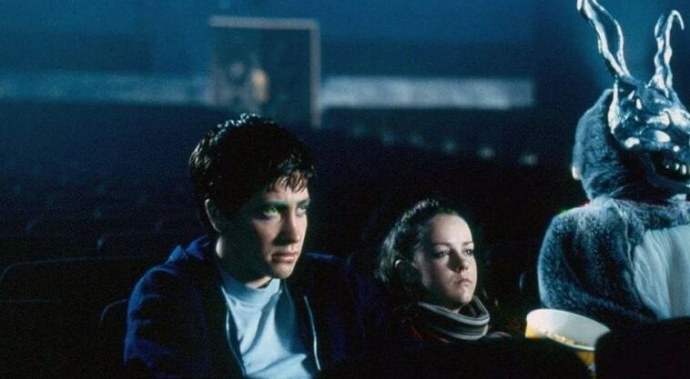 Jake Gyllenhaal And Jena Malone In Donnie Darko In A Movie Theater
